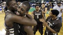 St. Bonaventure players Youssou Ndoye, left, of Senegal, and Canadian Andrew Nicholson celebrate after defeating Xavier 67-56 to win the NCAA college basketball championship game in the Atlantic 10 men's tournament in Atlantic City, N.J., March 11, 2012. (Mel Evans/The Associated Press/Mel Evans/The Associated Press)