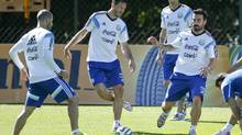 Argentina's Martin Demichelis, center, kicks the ball next to teammates Ezequiel Lavezzi, right, and Javier Mascherano, left, as Angel di Maria, second right, looks on during a training session in Vespasiano, near Belo Horizonte, Brazil, Friday, June, 13, 2014. Argentina will play in group F of the Brazil 2014 soccer World Cup. (Victor R. Caivano/AP Photo)