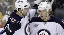 Winnipeg Jets' Bryan Little (right) celebrates his goal with Blake Wheeler during the third period of an NHL hockey game against the Pittsburgh Penguins in Pittsburgh, Saturday, Feb. 11, 2012. The NHL has noticed what his teammates have been saying for some time - right-winger Wheeler is a star for the Winnipeg JetsTHE CANADIAN PRESS/AP/Gene J. Puskar (Gene J. Puskar)
