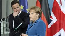 German Chancellor Angela Merkel and British Prime Minister David Cameron met in Berlin on Thursday. (TOBIAS SCHWARZ/REUTERS)