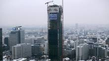 The Cosmopolitan mixed-use tower goes up in the centre of Warsaw. Poland's capital is one of the few Central European cities where cranes are working on projects such as the 160-metre-tall Cosmopolitan tower, a mixed retail, office and residential project. (Peter Andrews/Reuters)