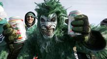 A Saskatchewan Roughriders fan arrives in costume for the CFL's 101st Grey Cup championship football game in Regina, Saskatchewan November 24, 2013. (MARK BLINCH/REUTERS)