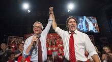 Liberal Adam Vaughan celebrates his by-election win in the Trinity-Spadina riding with party leader Justin Trudeau at the Steam Whistle Brewery in Toronto on Monday June 30, 2014. THE CANADIAN PRESS/Aaron Vincent Elkaim (Aaron Vincent Elkaim/THE CANADIAN PRESS)