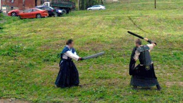 <p>An image of Live Action Role Players sword fighting caught on Google Street View. The subject's faces have been blurred by Google to protect their privacy.</p>