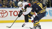 Ottawa Senators right wing Bobby Ryan (6) shoots the puck as Buffalo Sabres defenceman Christian Ehrhoff (10) defends during the first period at First Niagara Center. (Kevin Hoffman/USA TODAY Sports)