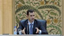 Syria's President Bashar al-Assad speaks to the new government in Damascus in this handout photo distributed by Syrian News Agency on June 26, 2012. (SANA/REUTERS)