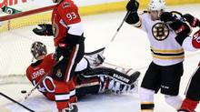 Boston Bruins' Daniel Paille (20)celebrates his goal as Ottawa Senators goaltender Robin Lehner (40) and Mika Zibanejad (93) look on during second period NHL action in Ottawa Thursday March 21, 2013. (FRED CHARTRAND/THE CANADIAN PRESS)