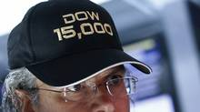 Specialist trader Donald Civitanova wears a hat to celebrate the Dow Jones Industrial average surpassing 15,000 during trading day on the floor at the New York Stock Exchange, May 3, 2013. (BRENDAN MCDERMID/REUTERS)