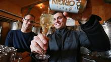 """During tours at the winery, Between the Lines staff will often serve vidal and ask visitors to guess what they're sipping. """"We always have people telling us it's chardonnay or riesling,"""" says Yannick Wertsch, right. """"When we tell them it's vidal they're always surprised."""" (Glenn Lowson For The Globe and Mail)"""