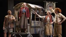 Seana McKenna (centre) as Mother Courage with E.B. Smith (left) as Eilif, Carmen Grant as Kattrin and Antoine Yared as Swiss Cheese in Mother Courage and Her Children. (David Hou/Stratford Festival)