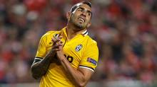 FILE - In this April 24, 2014 file photo, Juventus' Carlos Tevez reacts after missing a chance to score during a Europa League soccer semifinal at Benfica's Luz Stadium in Lisbon, Portugal. (Associated Press)