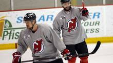 New Jersey Devils' Ilya Kovalchuk (R) celebrates a goal as his teammate Alexei Ponikarovsky skates in front of him during a team practice before Game 2. REUTERS/ (Mike Segar/Reuters)