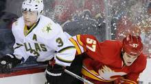 Calgary Flames' Lance Bouma (57) hits Dallas Stars' Stephane Robidas during the first period of their NHL hockey game in Calgary, Alberta March 4, 2012. REUTERS/Mike Sturk (STRINGER/CANADA)