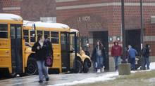 Students leave a high school in Le Roy, N.Y., in 2012, when 15 pupils reported having spasmas and seizures that were later attributed to mass hysteria. (Max Schulte/AP)
