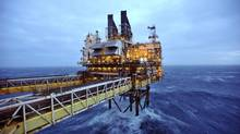 IEA's September oil market report says economic weakness in Europe, China prompted a tempered outlook for 2014 and 2015. (POOL/REUTERS/Newscom)