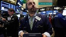 Stocks are selling off across North America and around the world. Trader Michael Hagis works on the floor of the New York Stock Exchange June 11, 2013. (Richard Drew/AP)