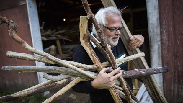 Maxwell Newhouse loads up his truck with driftwood October 17, 2013 at his studio in Chilliwack found around Vancouver Island. (John Lehmann/The Globe and Mail)