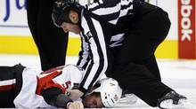 Ottawa Senators' David Dziurzynski lies on the ice as referee Lonnie Cameron tends to him after he was hit in a fight with Toronto Maple Leafs' Frazer McLaren (not seen) during the first period of their NHL game in Toronto March 6, 2013. (MARK BLINCH/REUTERS)