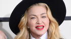 Madonna wears a grill as she arrives at the 56th annual Grammy Awards at Staples Center on Sunday, Jan. 26, 2014, in Los Angeles.