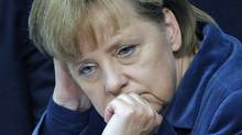 German Chancellor Angela Merkel listens to a speech at the German federal parliament, Bundestag, in Berlin, Germany, Wednesday, Oct. 26, 2011. (Michael Gottschalk/AP)