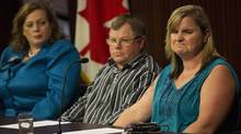 Pat and Sheri Leighton, whose son Eric Leighton was killed by an explosion at Mother Theresa Catholic High School last year, sit next to MPP Lisa MacLeod, left, as they answer questions from the media concerning their call for a coroner's inquest into their son's death at Queen's Park in Toronto on Sept. 13, 2013. (Michelle Siu/THE CANADIAN PRESS)