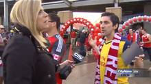 Shauna Hunt interviews a soccer fan in Toronto on Sunday, May 10, 2015, in this video frame grab. A man caught on video hurling obscenities at a female TV reporter is now out of a job. Hydro One says it is taking steps to terminate one of its employees for violating the company code of conduct. (HO/The Canadian Press)