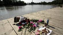 A memorial to 15 year old Tina Fontaine sits on the Alexander Docks along the Red river from which her body, in a bag, was recovered Sunday in Winnipeg Manitoba, August 19, 2014. (LYLE STAFFORD For The Globe and Mail)