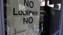 Sign reading No Loblaws can be seen in the window of a Kensington Market store on Augusta Ave.,Toronto April 04 2013. (Fernando Morales/The Globe and Mail)