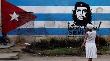 A wall is covered with a mural of the Cuban flag and an image of Cuba's revolutionary hero Ernesto (Che) Guevara in Havana on Jan. 27, 2012. (FRANKLIN REYES/ASSOCIATED PRESS)