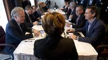 British Columbia Premier Christy Clark, centre, chairs a meeting of the Council of the Federation as Quebec Premier Jean Charest, left, and Ontario Premier Dalton McGuinty, right, look on in Victoria, B.C. on Jan. 16, 2012. (JONATHAN HAYWARD/CP)