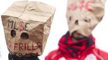 Toronto FC fans wear paper bags as a protest against the team's performance during their 1-0 defeat to D.C. United in MLS action in Toronto on Saturday, October 6, 2012 (The Canadian Press)