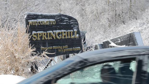 A car drives past a welcome sign to Springhill. The town will no longer be considered a town and will be amalgamating with the County of Cumberland. (Nance Ackerman For The Globe and Mail)