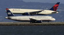 Delta and US Airways both beat the Street. (Lucy Nicholson/Reuters/Lucy Nicholson/Reuters)