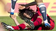 Team Canada's Taylor Paris gets pushed to the ground by Japan's Ayumu Goromaru during their international rugby match at Swangard Stadium in Burnaby, B.C., Saturday, June, 7. (JONATHAN HAYWARD/THE CANADIAN PRESS)