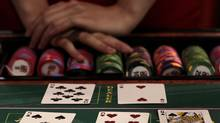 Cards and casino chips are displayed during the Global Gaming Expo Asia in Macau June 9, 2010. (Tyrone Siu/Reuters/Tyrone Siu/Reuters)