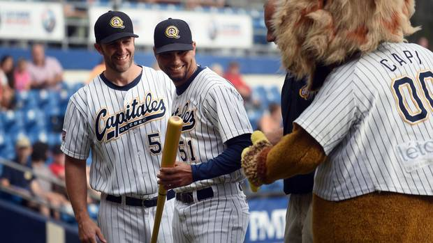 Yuniesky Gurriel (CENTRE) was awarded a golden bat for winning the Can-Am League's batting title with a .374 average. Patrick Scalabrini, Director of Operations is LEFT. Four Cuban baseball players were legally allowed to leave the country to play baseball in Canada for the Quebec Capitales. This is a new venture for Cuba which is now only beginning to see a thaw in it's relationship with the United States.
