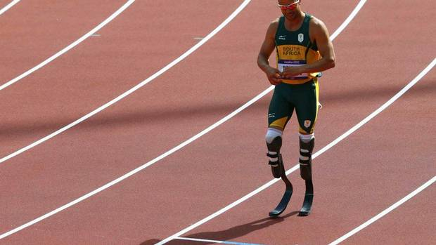 The Olympic dream of South Africa's Oscar Pistorius became a reality on Saturday when he ran in a round 1 heat in the Men's 400 metres at the Olympic Stadium in London. (DAVID GRAY/REUTERS)
