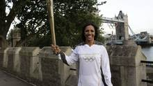 The Olympic Flame is seen in the grounds of the Tower of London during Day 63 of the Torch Relay in central London July 20, 2012. (POOL/REUTERS)