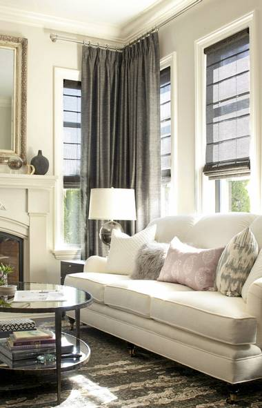 A consistent colour scheme - dark wood floors, ivory trim and ceilings, linen walls, and feature wall papers with ebony and ivory prints - creates unity of tone. (Barry Calhoun/Barry Calhoun)