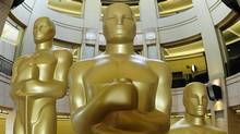 Oscar statues stand ready at the Kodak Theatre in Hollywood on Saturday. (ROBYN BECK/AFP/Getty Images)