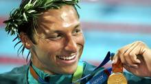 In this 2004 photo, Ian Thorpe of Australia, smiles with his gold medal after winning the 200-meter freestyle event (MARK J. TERRILL/AP)