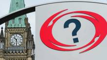 A National Capital Commission information sign sits across from the Peace Tower in Ottawa on April 28, 2011. (Sean Kilpatrick/The Canadian Press)