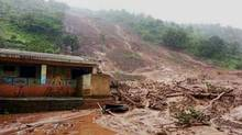 Mud and slush surround a building after a mudslide in the western Indian state of Maharashtra on July 30, 2014. (PRESS TRUST OF INDIA/ASSOCIATED PRESS)