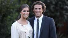 Uruguayan striker Diego Forlan, right, poses with his newly wed wife Paz Cardoso at Cardoso's house in Montevideo July 2, 2013. (HANDOUT/Reuters)