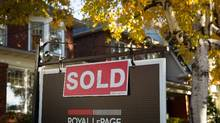 A sold sign hangs in front of a Toronto property on Nov. 4, 2016. (Graeme Roy/THE CANADIAN PRESS)