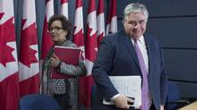 Heady Fry, chair of the Standing Committee on Canadian Heritage, and Conservative MP Peter Van Loan spoke about the committee's report on the state of the media on Thursday. (Adrian Wyld/THE CANADIAN PRESS)