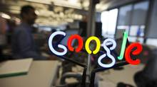 A neon Google logo is seen as employees work at the new Google office in Toronto, Nov.13, 2012. (MARK BLINCH/REUTERS)