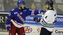 Kitchener Ranger Jesse Young (left) during a brief shoving match with Plymouth Whalers Nick Malysa during playoff action between the Rangers and the Whalers at the Kitchener Auditorium on April 11 2012. (Fred Lum/The Globe and Mail)