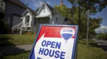 An open house sign in the Kitsilano neighbourhood in Vancouver. (Rafal Gerszak For The Globe and Mail)