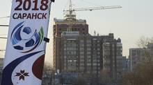 This Monday, Dec. 13, 2010 photo shows a street showing a banner of the 2018 World Cup in Saransk, the capital of the Mordovia region some 600 kilometers (350 miles) southeast of Moscow, Russia. Saransk is one of the 13 Russian cities expected to host the 2018 World Cup. The choice of Saransk, a tidy town of five-story, Soviet-style concrete apartment blocks, raises a number of questions, including: Why does the biggest sport event on earth need a provincial town 600 kilometers (350 miles) from Moscow? And, who might be benefiting from the Russian government's decision? (AP Photo/Mikhail Metzel) (Mikhail Metzel/AP)